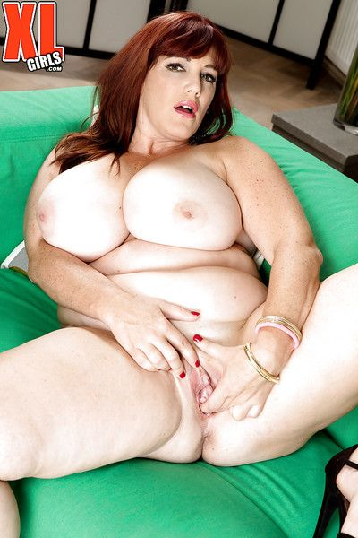 Fat older redhead Roxee Robinson exposing huge upfront tits in skivvies