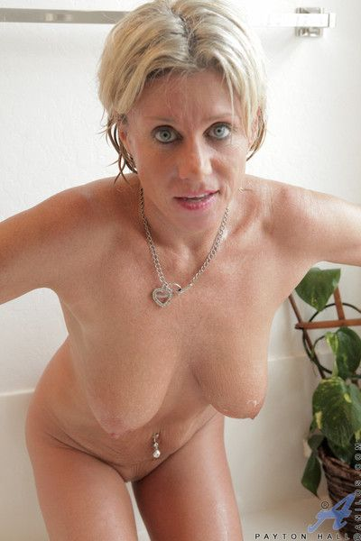 Anilos cougar gets muddied in be passed on bath remove and slides a toy in her pussy