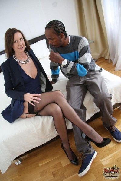 Lara latex fucks a huge dark-skinned locate