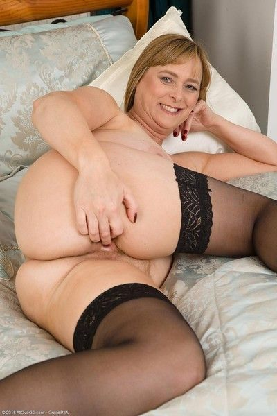 Busty mature toying in stockings