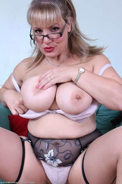 Busty motor coach toying in stockings