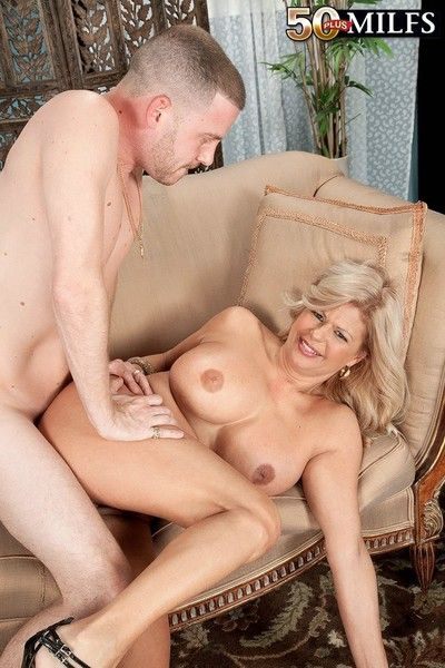 Grown-up with beamy tits and pierced pussy
