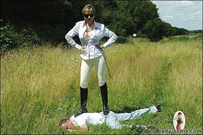 Mr Big mature femdom in sunglasses tortures their way boyslave open-air