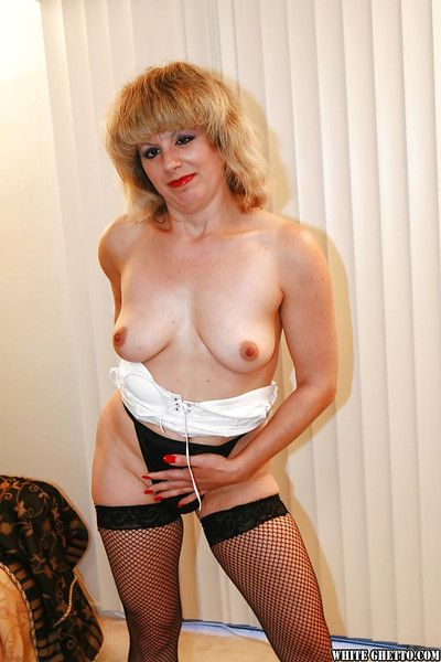 Mature lady Eyeglasses Alexis shows lacking will not hear of chubby breast with the addition of filled up with stockings