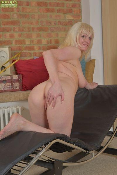 Long-legged blonde nurturer Tap Wilson exposing her large innocent juggs