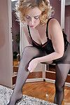 Blonde matured baby hither black distribute inform of pantyhose gives a warming-up legjob