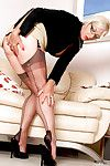 Fully clothed older businesswoman slips retire from pumps to reveal stocking trotters
