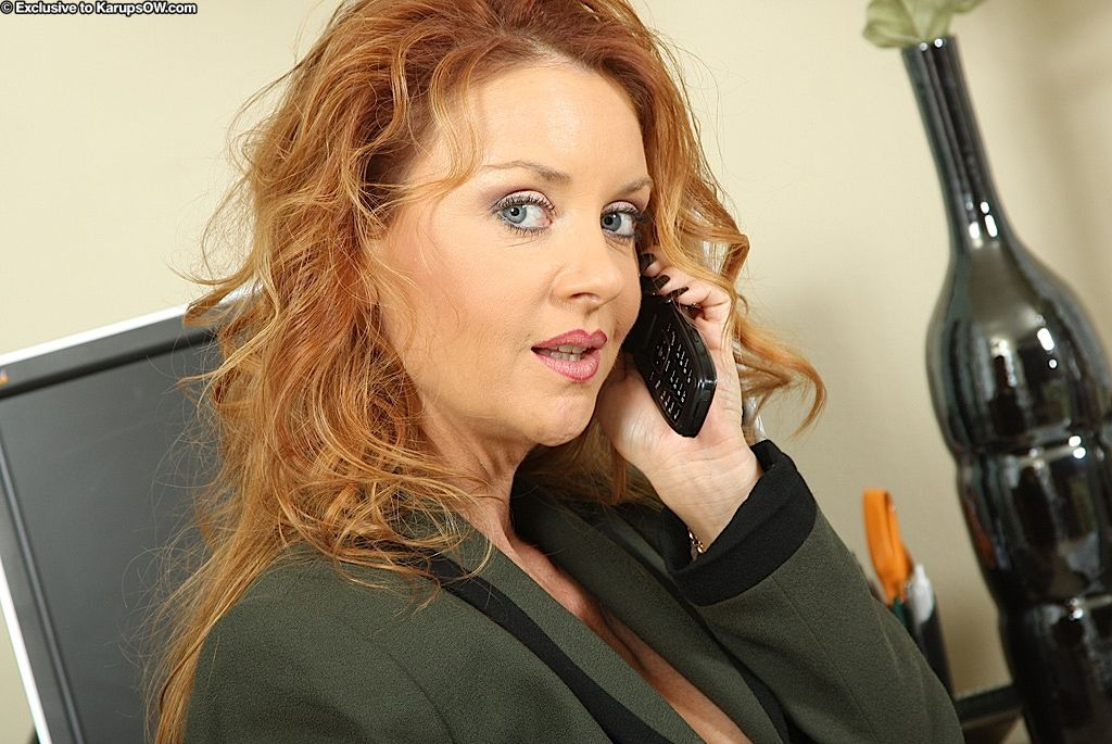 Curly-haired redhead office lady in nylons undressing coupled with exposing her gash