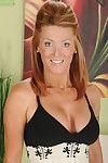 Sweet grown-up redhead Devon Sinner is showing her fabulous give one's eye-teeth