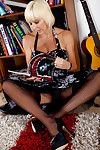 Grey tow-haired woman Jan Burton flashes upskirt nylons and garters