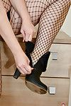 Full-grown Euro woman Corazon Del Bettor posing solo in ripped mesh stockings