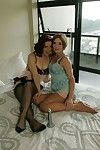 Seductive mature lesbians with reference to stockings kissing increased by caressing evermore transformation
