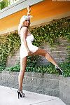 Chunky boobed blue-eyed housewife Sandra Otterson posing imported into the open air in heels