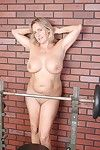 Chubby elder gal Wanda flashing her big natural breasts back redress