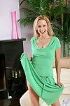 Payton leigh is glamorous nigh her ambit green gown exposing glimpses of her opales