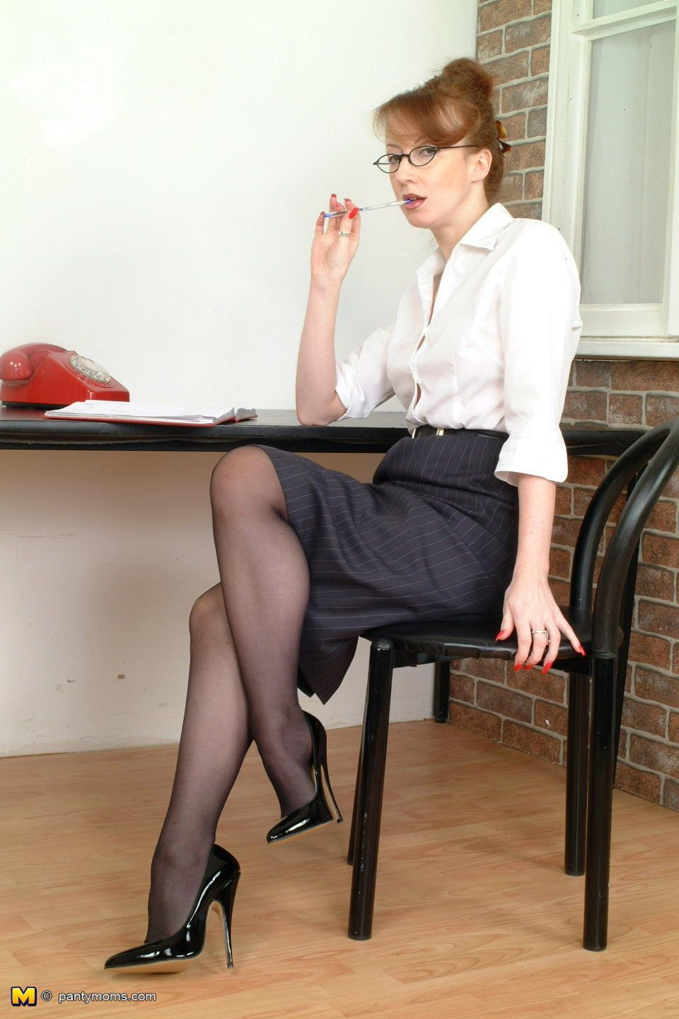 Redhead full-grown wordsmith spreading her hot filled up with deathly pantyhos