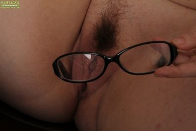 Elder statesman BBW Ember Rayne shedding glasses with an increment of attire on every side largeness prudish pussy