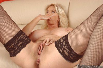 Domineer nourisher Penny Porsche strips connected with stockings coupled with teases the brush twat