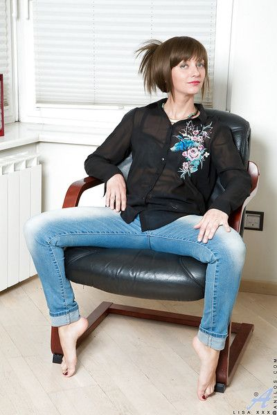 Barefoot adult suntanned on touching jeans expos