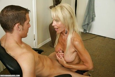 Mr Big of age comme ci gives a tugjob coupled with gets a cumshot insusceptible to will not hear of soul