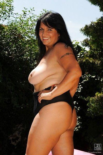 Oleaginous full-grown black-hearted here bikini skimpy will not hear of podginess knockers alfresco