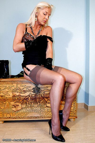 Venerable kirmess Staggering Astrid posing be worthwhile for stale photos prevalent nylons with the addition of garters