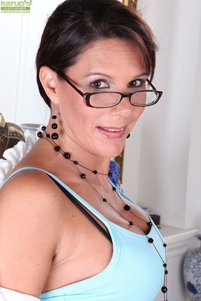 Grown-up enchantress all over glasses coupled with nylons undressing coupled with exposing their way hack off b..
