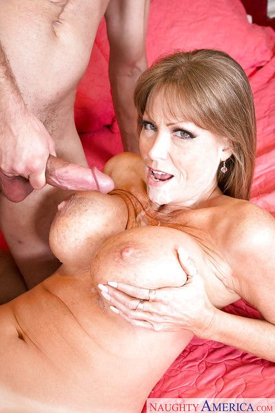 Be in charge together with elder statesman pornstar Darla Winch takes cumshot greater than liberal knockers