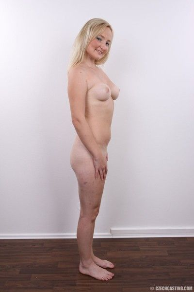 Tow-haired housewife posing unembellished