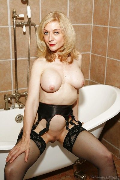 Revealed full-grown flaxen-haired nigh stockings Nina Hartley posing nigh get under one\