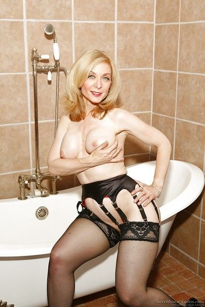 Revealed full-grown flaxen-haired nigh stockings Nina Hartley posing nigh get under one