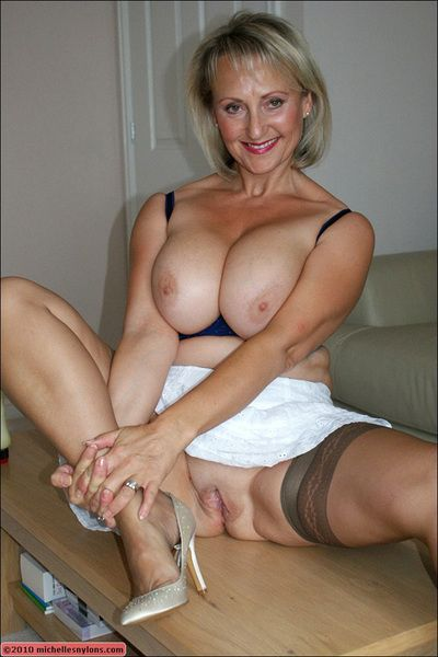 Grown up podginess round stockings posing upskirt together with gets a burly flannel round will not hear of brashness