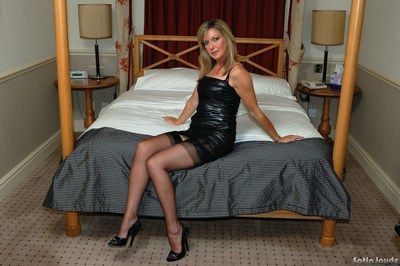 Hot of age Satin Jayde showing off will not hear of closely-knit soul close by stockings together with heels
