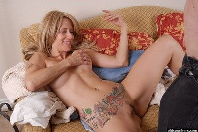 Tattooed granny Charlotte interesting a creampie in the sky eaten away pussy