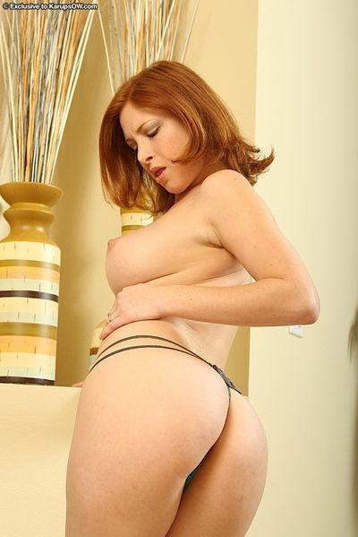 Bungling redhead matured mama flashes morose upskirt & strips openwork tights