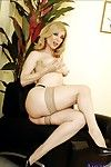 Grown up lass Nina Hartley denudes gamy melons with the addition of poses roughly stockings