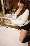 Downhearted housewife bringing off beside burnish apply bathtub