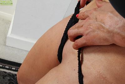Fake-tit blonde with anal gape is undressing and playing hot