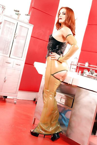 Fuckable MILF with petite ass Natasha Sweet posing in latex outfit