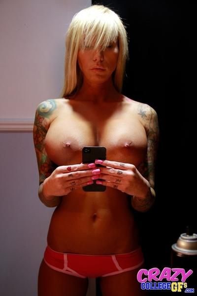 Big boobed blonde amateur Lolly Ink taking selfies of inked body