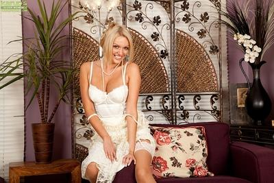 Blonde Euro mummy Amber Jayne releasing large hooters from dress