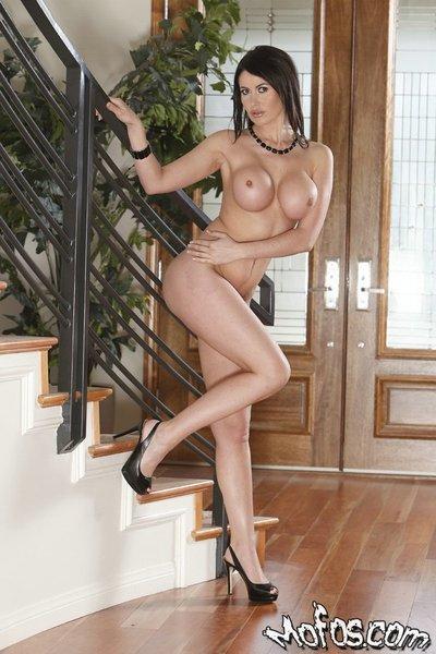 Sexy MILF with big round boobies Eva Karera slipping off her panties