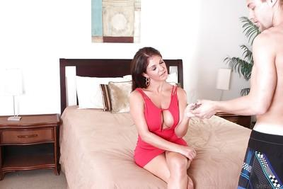 Milf pornstar Coralyn Jewel dose blowjob in a red skirt and high heels