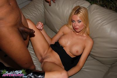 Barbi Sinclair lets her black stag take her sexy white lingerie before nailing her MILF pussy with his dong.