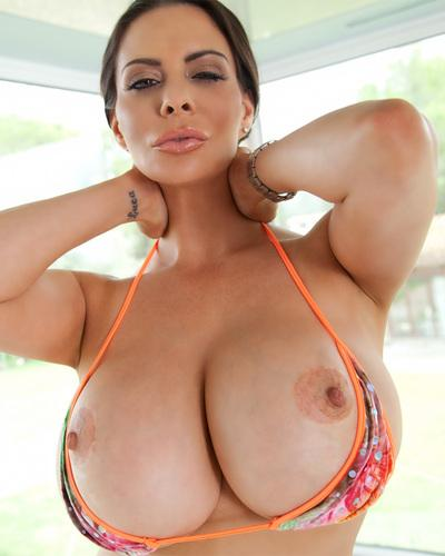 Solo girl Linsey Dawn McKenzie unleashes large natural tits from bikini
