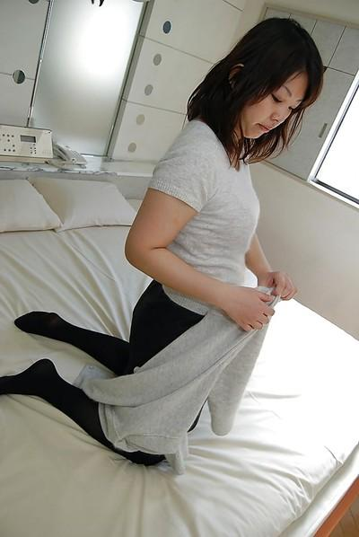 Asian MILF Kozue Marui undressing and exposing her soaking twat in close up