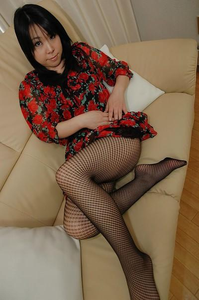 Asian MILF in pantyhose stripping and spreading her hairy pussy lips