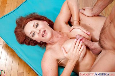 Redhead cougar Janet Mason takes a younger man