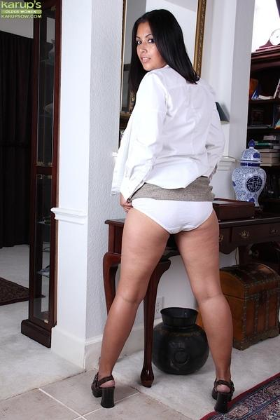 Latina mummy Veronica playing with her large all natural breasts