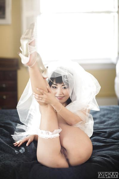 Sexy Asian bride Marica Hase removing wedding dress for nude photo spread